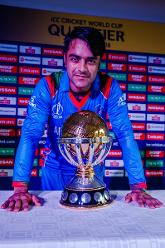 Afghanistan captain Rashid Khan with the ICC World Cup Qualifier Trophy at Harare Sports Club.