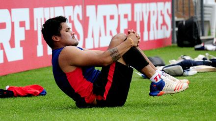 Nepal bowler Karan KC stretches ahead of practice session at Queens Sports Club.