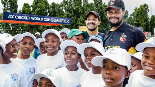 PNG players pose for a photo with youngsters from Harare townships in the cricket for good sessions after a training session for Papua New Guinea at Harare Sports Club March 3 2018.
