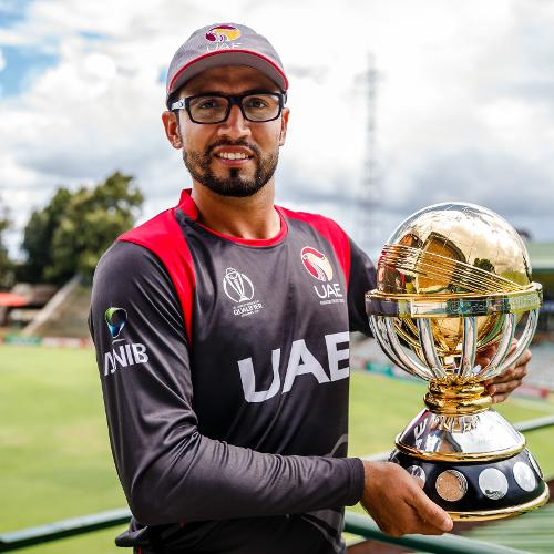 UAE captain Rohan Mustafa holds the ICC World Cup Qualifiers trophy before a training session for the United Arab Emirates at Harare Sports Club March 3 2018.