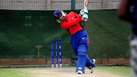Nepal All-Rounder Dipendra Airee plays extravagant cut shot in the nets during their practice session at Queens Sports Club.
