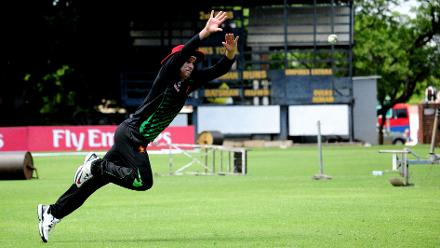 Zimbabwe fielder Malcom Waller dives towards the ball during their practice session ahead of their first match against Nepal on the 4th of March.