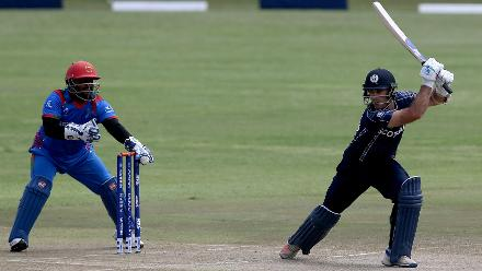 Kyle Coetzer (R) of Scotland is stumped by M Shazad (L) off the bowling of Mujeeb Ur Rahman (unseen) of Afghanistan during the ICC Cricket World Cup Qualifier between Afghanistan and Scotland at the BAC Stadium on March 4, 2018 in Bulawayo, Zimbabwe.