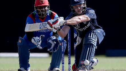 George Munsey (R) of Scotland plays a shot past xx of Afghanistan during the ICC Cricket World Cup Qualifier between Afghanistan and Scotland at the BAC Stadium on March 4, 2018 in Bulawayo, Zimbabwe.