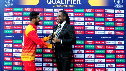 Top order Zimbabwean batsman all smiles after receiving player of the match award from Vumi Ndaba Moyo Zimbabwe Cricket board member, for excellent performances with both bat and bowl against Nepal in the opening match of Group B at QSC.