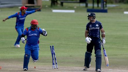 Kyle Coetzer (R) of Scotland looses his wicket to Mujeeb Ur Rahman (unseen) of Afghanistan during the ICC Cricket World Cup Qualifier between Afghanistan and Scotland at the BAC Stadium on March 4, 2018 in Bulawayo, Zimbabwe.