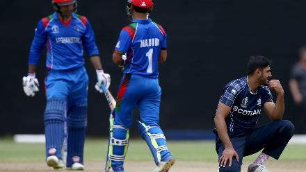 Safyaan Sharif (R) of Scotland reacts during the ICC Cricket World Cup Qualifier between Afghanistan and Scotland at the BAC Stadium on March 4, 2018 in Bulawayo, Zimbabwe.