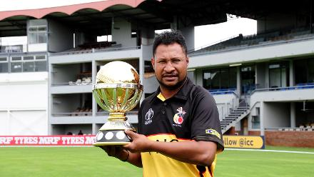 Papua New Guinea Captain Assad Vala holding the ICC CWCQ trophy at Queens Sports Club.