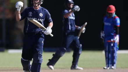 Calum MacLeod (C) and George Munsey (L) of Scotland celebrate after the ICC Cricket World Cup Qualifier between Afghanistan and Scotland at the BAC Stadium on March 4, 2018 in Bulawayo, Zimbabwe.