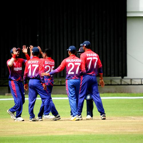 Nepal players celebrate after bagging their wicket in the group B ICC World Cup Qualifier match against Zimbabwe at Queens Sports Club in Bulawayo.
