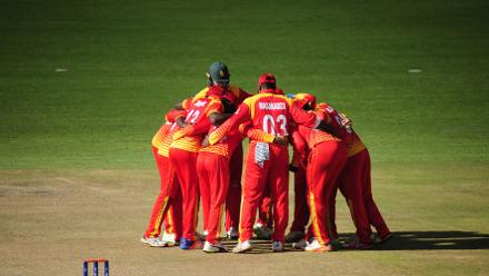 Team Zimbabwe celebrates spin bowler Sikandar Raza's LBW wicket of Sharad Vesawkar at Queens Sports Club in the opening match of Group B, ICC World Cup Qualifiers in Bulawayo.