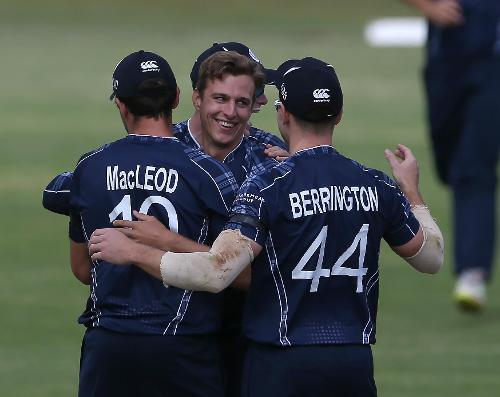 Brad Wheal of Scotland celebrates with teamates after taking the wicket of Inhsanullah of Afghanistan during the ICC Cricket World Cup Qualifier between Afghanistan and Scotland at the BAC Stadium on March 4, 2018 in Bulawayo, Zimbabwe.
