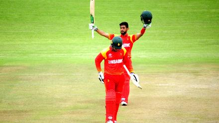 Zimbabwe top order batsman Sikandar Raza celebrates his century in the opening match at Queens Sports Club in Bulawayo as the hosts post a total of 380/6 in Bulawayo .