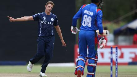 Brad Wheal (L) of Scotland celebrates taking the wicket of Mujeeb Ur Rahman of Afghanistan during the ICC Cricket World Cup Qualifier between Afghanistan and Scotland at the BAC Stadium on March 4, 2018 in Bulawayo, Zimbabwe.