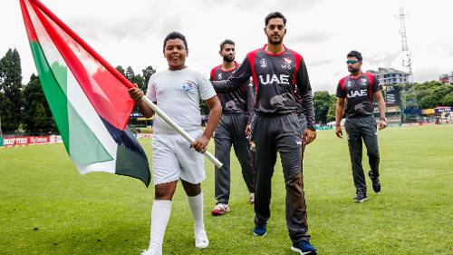 UAE players with a flag bearer before a group A World Cup Qualifier match between Papua New Guinea and the United Arab Emirates at Harare Sports Club March 4 2018.