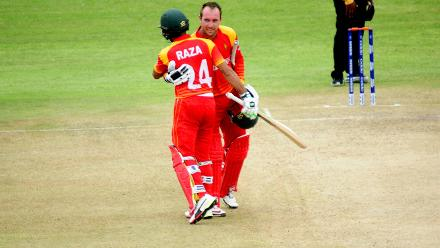Top order batsmen Brendan Taylor and Sikandar Raza embrace as they celebrate Brendan Taylor's century scored off 91 balls with 7 fours and one six in the opening match of the ICC Cricket World Cup Qualifier held at QCC in Bulawayo against Nepal.