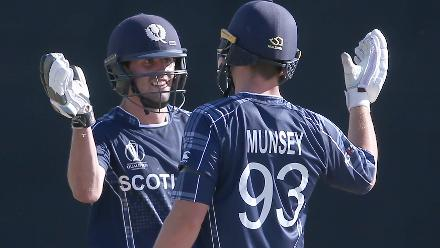 Calum MacLeod (L) celebrates with George Munsey of Scotland after reaching his 150 during the ICC Cricket World Cup Qualifier between Afghanistan and Scotland at the BAC Stadium on March 4, 2018 in Bulawayo, Zimbabwe.