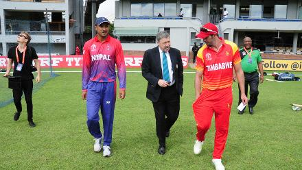 The cricket captains of Zimbabwe and Nepal walk onto the park together with ICC match referee David Dukes at Queens Sports Club 04 March 2018.
