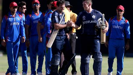 Calum MacLeod (centre left) and George Munsey of Scotland celebrate after the ICC Cricket World Cup Qualifier between Afghanistan and Scotland at the BAC Stadium on March 4, 2018 in Bulawayo, Zimbabwe.