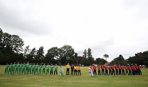 Match officals and teams line up for the playing of The National Anthems before the ICC Cricket World Cup Qualifier between Ireland and The Netherlands at The Old Hararians Ground on March 4, 2018 in Harare, Zimbabwe.