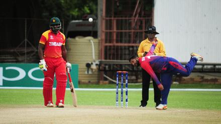 Basant Regmi bowls during the power play overs to Zimbabwe's openers in their Group B ICC World Cup Qualifier match at Queens Sports Club in Bulawayo.
