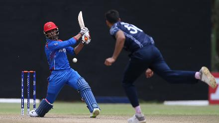 Dawlat Zadran (L) of Afghanistan plays a shot during the ICC Cricket World Cup Qualifier between Afghanistan and Scotland at the BAC Stadium on March 4, 2018 in Bulawayo, Zimbabwe.