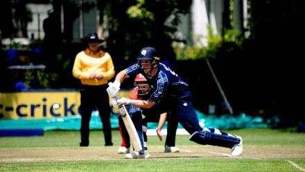 Scotland batsman George Munsey plays a drive against Hong Kong at BAC, March 6 2018 (©ICC).