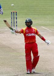 Sikandar Raza of Zimbabwe reacts after reaching his 50 during the ICC Cricket World Cup Qualifier between Zimbabwe and Afghanistan at Queens Sports Club on March 6, 2018 in Bulawayo, Zimbabwe (©ICC).