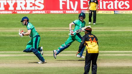 Ireland batsman Ed Joyce (L) in action with captain William Porterfield (R) during a Group A World Cup Qualifier cricket match between Papua New Guinea and Ireland at Harare Sports Club, March 6 2018 (©ICC).