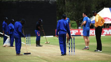 Umpires and groundsmen inspect the wicket at BAC, March 8 2018 (©ICC).