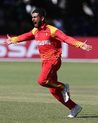 Sikandar Raza of Zimbabwe celebrates taking the wicket of Rashid Khan of Afghanistan during the ICC Cricket World Cup Qualifier between Zimbabwe and Afghanistan at Queens Sports Club on March 6, 2018 in Bulawayo, Zimbabwe (©ICC).
