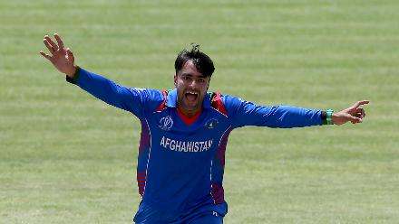 Rashid Khan Arman of Afghanistan celebrates taking the wicket of Brian Vitori of Zimbabwe during the ICC Cricket World Cup Qualifier between Zimbabwe and Afghanistan at Queens Sports Club on March 6, 2018 in Bulawayo, Zimbabwe (©ICC).