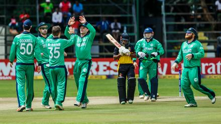 Ireland captain William Porterfield celebrates a wicket with his team mates during a Group A World Cup Qualifier cricket match between Papua New Guinea and Ireland at Harare Sports Club, March 6 2018 (©ICC).