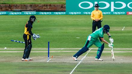 Ireland batsman Andrew Babirnie looses his wicket as PNG wicket keeper Jack Vare looks on during a Group A World Cup Qualifier cricket match between Papua New Guinea and Ireland at Harare Sports Club, March 6 2018 (©ICC).