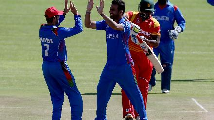 Dawlat Zadran (C) of Afghanistan celebrates taking the wicket of Cephas Zhuwao (2ndR) of Zimbabwe during the ICC Cricket World Cup Qualifier between Zimbabwe and Afghanistan at Queens Sports Club on March 6, 2018 in Bulawayo, Zimbabwe (©ICC).