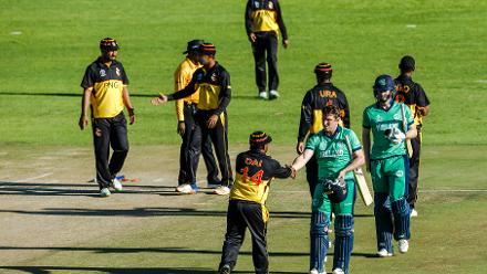 Ireland batsman Gary Wilson (L) and George Dockrell (R) shakes hands with PNG players after victory during a Group A World Cup Qualifier cricket match between Papua New Guinea and Ireland at Harare Sports Club, March 6 2018 (©ICC).