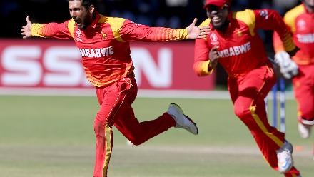 Sikandar Raza celebrates taking the wicket of Rashid Khan