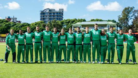 Ireland players embrace one another as their national anthem is played during a Group A World Cup Qualifier cricket match between Papua New Guinea and Ireland (©ICC).