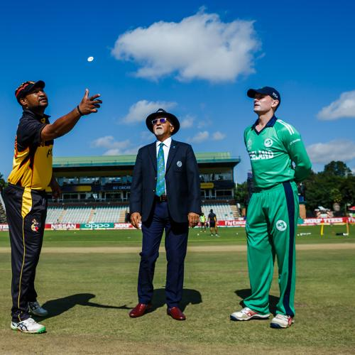 PNG captain Assadollah Vala tosses the coin as Ireland captain William Porterfield looks on during a Group A World Cup Qualifier cricket match between Papua New Guinea and Ireland at Harare Sports Club, March 6 2018 (©ICC)