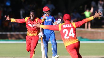 Brian Vitori (L) of Zimbabwe celebrates taking the last wicket of Shahpur Zadran of Afghanistan during the ICC Cricket World Cup Qualifier between Zimbabwe and Afghanistan at Queens Sports Club on March 6, 2018 in Bulawayo, Zimbabwe (©ICC).