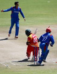 Mujeeb Ur Rahman (L) of Afghanistan takes the wicket of Hamilton Masakadza (C) of Zimbabwe during the ICC Cricket World Cup Qualifier between Zimbabwe and Afghanistan at Queens Sports Club on March 6, 2018 in Bulawayo, Zimbabwe (©ICC).