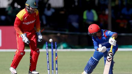 Rashid Khan (R) of Afghanistan is bowled out by Sikandar Raza (unseen) of Zimbabwe during the ICC Cricket World Cup Qualifier between Zimbabwe and Afghanistan at Queens Sports Club on March 6, 2018 in Bulawayo, Zimbabwe (©ICC).