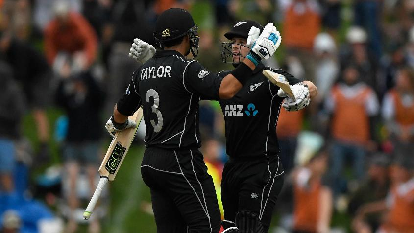 Ross Taylor celebrates with Henry Nicholls after taking New Zealand over the line