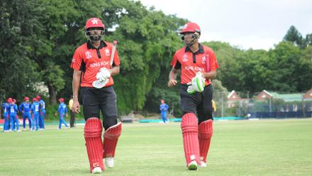 Hong Kong batsmen Waqas Barkat and Ehsan Nawaz walk off the pitch after posting a total of 241/8 against Afghanistan in their Group B, ICC Cricket World Cup Qualifier at BAC in Bulawayo, Mar 8 2018 (©ICC).