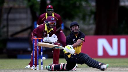 Shai Hope of The Windies looks on as Assadollah Vala of Papua New Guinea slips during The Cricket World Cup Qualifier between The Windies and Papua New Guinea at The Old Hararians on March 8, 2018 in Harare, Zimbabwe (©ICC).