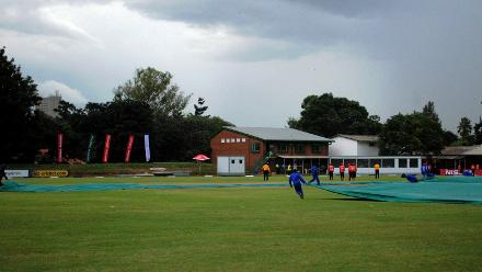 Rain puts a halt to proceedings as the groundsmen rush onto the pitch with the covers with Afghanistan 167/7 in their Group B ICC Cricket World Cup Qualifier clash against Hong Kong at BAC in Bulawayo, Zimbabwe on 8 March 2018 (©ICC).