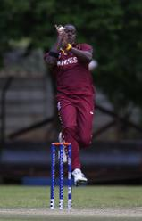 Carlos Brathwaite of The Windies bowls during The Cricket World Cup Qualifier between The Windies and Papua New Guinea at The Old Hararians on March 8, 2018 in Harare, Zimbabwe (©ICC).