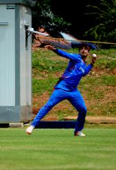 Afghanistan fielder Sharafuddin Ashraf throws the ball to the strikers end against Hong Kong in their Group B, ICC Cricket World Cup Qualifier at BAC in Bulawayo, Mar 8 2018 (©ICC).