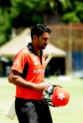 Hong Kong batsman Anshuman Rath walks off after scoring 65runs off 90balls in a successful LBW appeal by Afghanistan bowler Mujeeb Rahman in their Group B, ICC Cricket World Cup Qualifier at BAC in Bulawayo, Mar 8 2018 (©ICC).