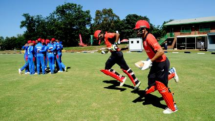 Hong Kong's Nizakat Khan and Aizaz Khan set off to open the batting against Afghanistan in a group B match, round three of the ICC Cricket World Cup Qualifiers Trophy at the Bulawayo Athletic Club, March 8 2018 (©ICC).